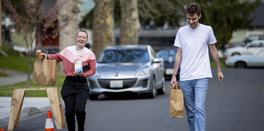 Students pick up sack lunches at Cleveland Commons
