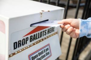 A ballot is inserted into an official drop box in Walla Walla