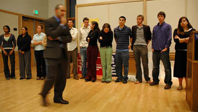 Professor Paul Apostolidis presents Politics 402 class to the audience.
