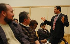 Uriel Iniguez, executive director, State of Washington Commission on Hispanic Affairs, addresses crowd.