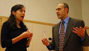 Student Paulina Oceguera speaks with Professor  Apostolidis.