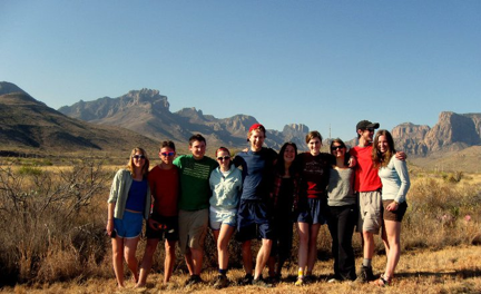 Students in front of the Chisos Mountains of Big Bend National Park.  From left to right, Katie Tackman, John Whiting, Will Cooper, Clara Easter, Will Bender, Rachel Alexander, Abbye Neel, Shannon Buckham, Matthew Morriss, and Geneva Faulkner.  (Photo by Bob Carson).