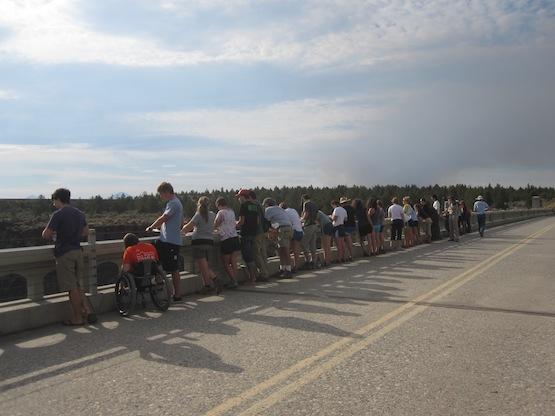 Students looking over a bridge railing on Fall Regional, 2011