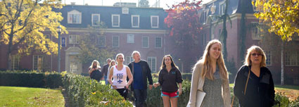 Whitman College students and parents walking across campus